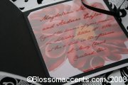 This exquisite invitation is perfect for a wedding with a blend of true black and white sophistication with a touch of colorful creativity. The bold classical style gatefold wrap is a heavy weight paper revealing a beautiful bold red blossom underneath translucent vellum. Invitation is hand tied for finishing touch. -  - Blossom Accents