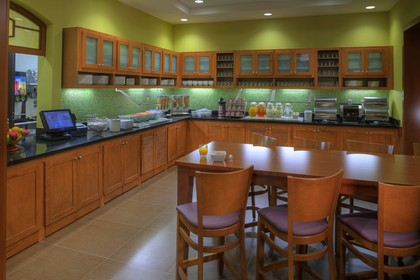 Guest Kitchen where complimentary continental breakfast is served.  -  - Hyatt Place West Palm Beach/Downtown