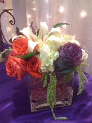 Low centerpieces with submersible lights with white star gazer, roses - Flowers and Decor - A Fairytale Wedding