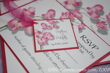 Orchid blossoms on a beautiful orchid wedding invitation. Text and artwork printed on rich white paper with an accent of a gorgeous shimmery fuschia border with hand tied ribbon details. -  - Blossom Accents