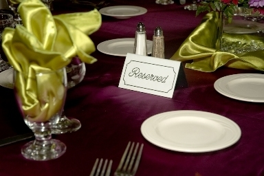 A Fairytale Wedding satin table cloths in a wide variety of colors.  Here we have our plum satin table cloth with our green satin napkins - Cakes and Desserts - A Fairytale Wedding
