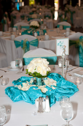 We used the bridesmaid bouquets as centerpieces, venue over looked the ocean and lagoon with tropical foliage everywhere, few flowers were needed.  Flowers and Decor - Honolulu Wedding In June in Honolulu, HI, USA