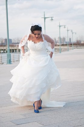 Dress and Veil are by Demetrios. 