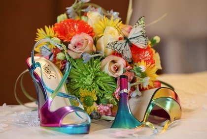 "I had a ""rainbow"" wedding and wanted the flowers to represent each color.  Brick Flower Market did an incredible job. Flowers and Decor - Kimberly and Dale's Wedding in Eatontown, NJ, USA"