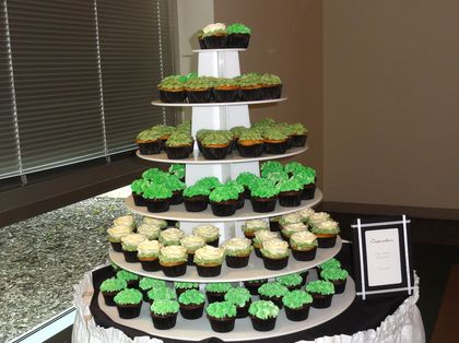 Chocolate ganache & vanilla cupcakes in black cups with green hydrangea and white rose frosting designs (Sweet Dreams Desserts, Sycamore, IL) Cakes and Desserts - Elgin Wedding In September in Elgin, IL, USA