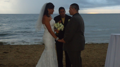 Glad the rain held out until it was time for the kiss The Ceremony - Sechel and Gilberto's Wedding in Rincon,  Puerto Rico