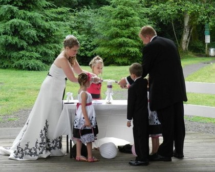We are a blended family I have 2 an dhe has 2 so we decided that our unity candle would be  about our family coming together as one! The Ceremony - Stayton O Wedding In July in Stayton, OR, USA