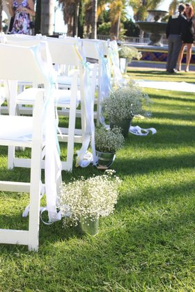 ceremony decor... baby's breath & ribbons... perfect for a garden ceremony Flowers and Decor - San Diego Wedding In October in San Diego, CA, USA