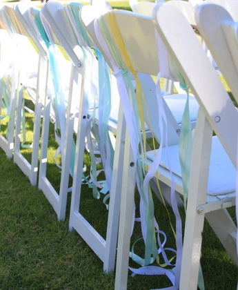 back row of ceremony chairs had simple & whimsical ribbons hanging off The Ceremony - San Diego Wedding In October in San Diego, CA, USA