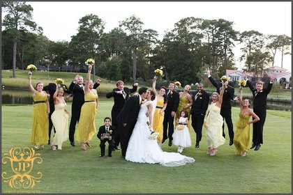 The bridesmaids wore a variety of yellow gowns in styles they chose themselves which were accented by navy blue sashes. The groomsmen sported black tuxes accented with navy blue ties and yellow vests and boutonnieres. Wedding Party Attire - Meagan & Nick's Wedding in Virginia Beach, VA, USA