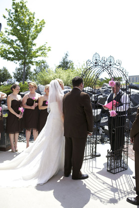 Our ceremony at The Yard at The Iron Horse Hotel. Arch provided by Lighthouse Florist. Officiated by Music 2 Remember. The Ceremony - Ashley and Chris's Wedding in Milwaukee, WI, USA
