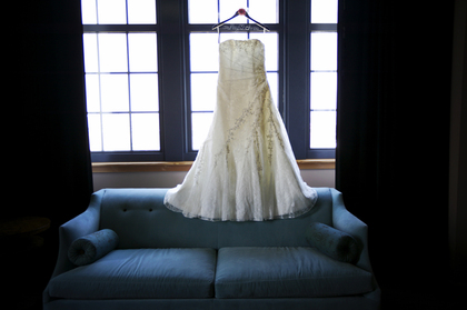 Vienna by Maggie Sottero. Photo taken in Iron Horse Hotel guestroom. The Wedding Dress - Ashley and Chris's Wedding in Milwaukee, WI, USA