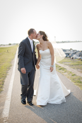 Casablanca- with some custom tailoring (the bodice was tucked/ pinned, the belt was swapped out & the tails on the back were edged on the bottom with crystals from the old belt) The Wedding Dress - Amy & Paul's Wedding in Norfolk, VA, USA