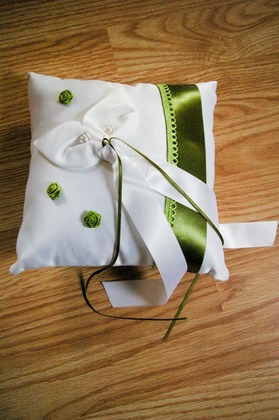 Our ring cushion which I bought plain white and then embellished with green ribbon and rose buds to go with our theme. Flowers and Decor - Clarissa and Marco's Wedding in Mandello del Lario, Italy