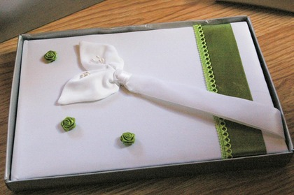 My guest book, also bought plain white and then embellished with green ribbon and rose buds like the ring cushion. Flowers and Decor - Clarissa and Marco's Wedding in Mandello del Lario, Italy