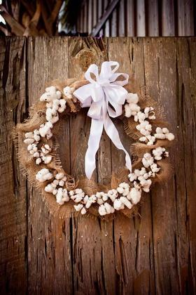 Because our wedding was on the Cotton Dock at an old southern cotton plantation, we decided that cotton was the ideal main decorative element. We love the raw natural beauty of cotton stalks and cotton pods. My mother made several of these wreaths to decorate the space, using cotton from a family cotton farm in south Georgia. Flowers and Decor - Kathryn and Andrew's Wedding in Charleston, SC, USA