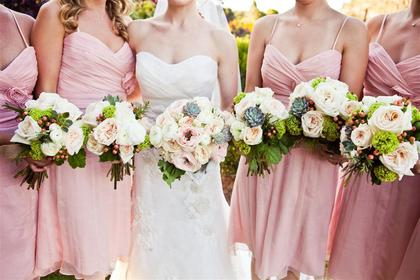 The bouquets featured ranunculus,succulents, dusty miller, garden roses, and hypercinum berries. Flowers and Decor - Kathryn and Andrew's Wedding in Charleston, SC, USA