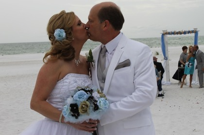 Sharing another newlywed kiss just before the reception. The Newlyweds - Kevin & Karen's Wedding in Anna Maria, FL, USA