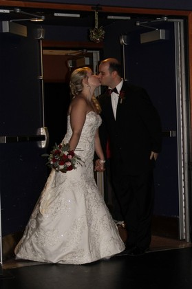Kissing under the mistletoe! The Newlyweds - Tabitha and Thomas's Wedding in Charleston, WV, USA