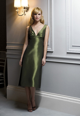 Tea-length v-neck Iridescent taffeta dress w/ pleated bodice and bow at back. 