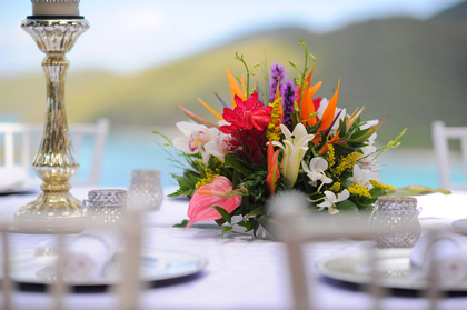 Beautiful table setting overlooking the Caribbean Sea- decor included with Island Style Weddings Coordination services  tropical flower centerpiece by Roses Too Photo by Blueglass Photography - Flowers and Decor - Island Style Weddings