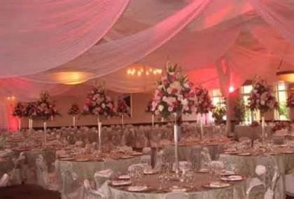 Ceiling, linens, centerpieces, up lighting and much more starting at $4000.00 total package for approximately 300 guests.  Call for more information.  -  - A SPARK OF ELEGANCE