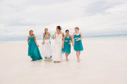 Bahamas wedding party stroll along the beach. - Wedding Party Attire - Chic Bahamas Weddings