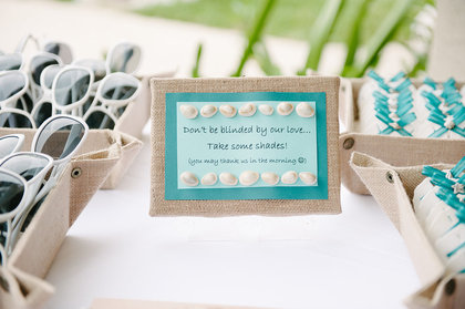 Escort card table with sand dollar escort cards and signage made by friend. - Flowers and Decor - Chic Bahamas Weddings