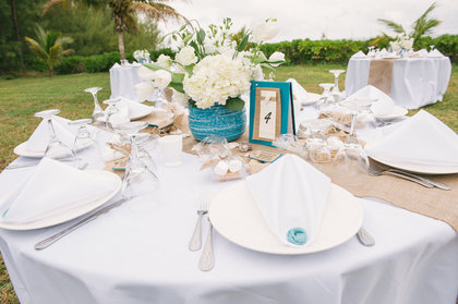 Tablescape of white and teal with burlap runner. - Flowers and Decor - Chic Bahamas Weddings