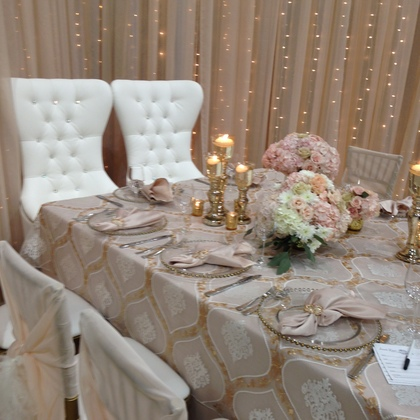 Waterfall of Lights Backdrop, Bride & Groom Chairs, Glass Chargers, Rose Gold Rhinestone napkin Rings, Gold CAndlestick Trio with Floating Candles, Beautiful Overlays - all available for Rent! - Flowers and Decor - Annie Lane Events & Decor