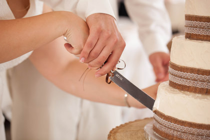 Cutting the cake. Cakes and Desserts - Harrisonburg Wedding In September in Harrisonburg, VA, USA