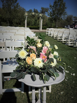 Ceremony at Dana Powers, flowers by Fluid Bloom. Flowers and Decor - Nicole and Tyler's Wedding in Pismo Beach, CA, USA